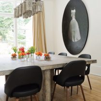 a blend of vintage and rustic luxury are combined in this dining room by siegel design of buckhead interiors atlanta